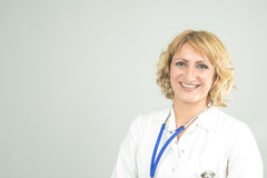 Portrait of Professional Smiling Physician. Over Gray Background. Horizontal Image Royalty Free Stock Photos