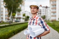 Young architect in front of apartment building Royalty Free Stock Image