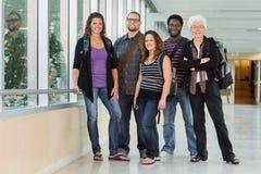 Portrait of Professor with Grad Students. Grad students standing with college professor Stock Images