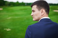 Portrait in profile of handsome groom in the nature Royalty Free Stock Photography