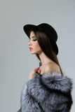 Portrait in profile of a woman in a black hat and fur Stock Photos