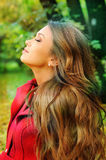 Portrait in profile of a young beautiful girl resting in a park. Portrait in profile of a young beautiful girl resting in a park with eyes closed Stock Image