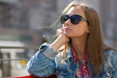 Portrait in profile of a young beautiful pensive girl in sunglas Royalty Free Stock Images