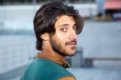 Portrait profile young muslim man. Portrait profile young muslim man against the background of the city street royalty free stock photography
