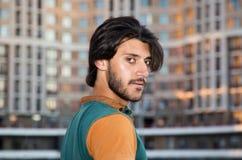 Portrait profile young muslim man. Portrait profile young muslim man against the background of the city street stock photo