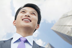 Portrait of Proud and Ambitious Businessman Looking Up Royalty Free Stock Photography