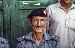 Portrait of proud elderly policeman in Peshawa Stock Photo