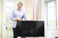 Portrait Of Proud Woman With New Television At Home Stock Photos