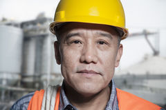Portrait of proud worker in protective workwear outside of a factory Stock Photography