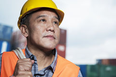 Portrait of proud worker in protective workwear in a shipping yard Stock Image