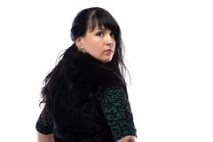 Portrait of pudgy woman in fur jacket, from back Royalty Free Stock Photo