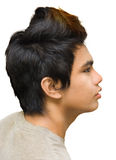 Portrait of punk Asian teenager. Profile or side portrait of seriously looking punk or emo Indian Asian teenager with dyed hair and crest. Isolated over white Stock Photos