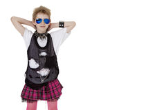 Portrait of punk kid in fancy dress with hands behind head over white background Stock Photo