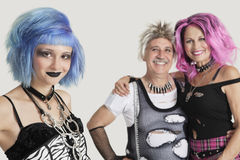 Portrait of punk male and females over gray background Stock Photography