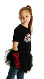 Portrait of a punk rock girl. Cute young girl isolated on a white background, wearing pirate punk clothes and rock star tutu Royalty Free Stock Photo
