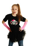 Portrait of a punk rock girl. Cute young girl isolated on a white background, wearing pirate punk clothes and rock star tutu Royalty Free Stock Images
