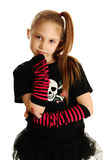 Portrait of a punk rock girl. Cute young girl isolated on a white background, wearing pirate punk clothes and rock star tutu Stock Photos