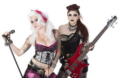 Portrait of punk rock musicians with electric guitar and microphone over white background Royalty Free Stock Photography