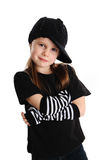 Portrait of a punk rock young girl with hat. Cute young preschool age girl isolated on a white background, wearing punk clothes and rock star Stock Photo
