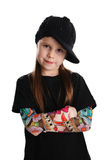Portrait of a punk rock young girl with hat. Cute young preschool age girl isolated on a white background, wearing tattoo punk clothes and rock star Stock Photos