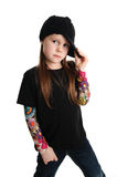 Portrait of a punk rock young girl with hat. Cute young preschool age girl isolated on a white background, wearing tattoo punk clothes and rock star Stock Images
