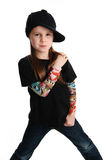 Portrait of a punk rock young girl with hat. Cute young preschool age girl isolated on a white background, wearing tattoo punk clothes and rock star Royalty Free Stock Images