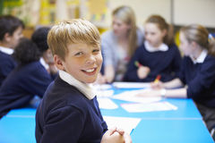 Portrait Of Pupil In Classroom With Teacher Stock Images