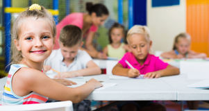 Portrait  pupil girl studying in school class Royalty Free Stock Photo