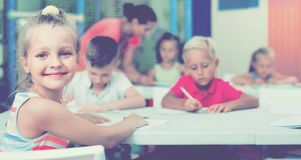 Portrait  pupil girl studying in school class Stock Image