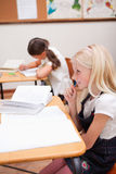 Portrait of pupils doing classwork Royalty Free Stock Photo