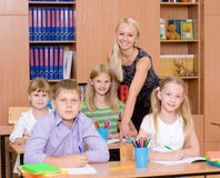 Portrait of pupils and their teacher in a classroom Stock Photography