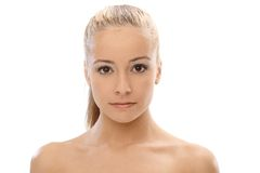 Portrait of pure woman. Portrait of young blonde pure woman with bare shoulders Royalty Free Stock Photography