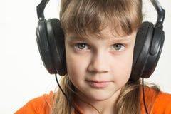Portrait of purposeful girl with headphones Stock Image