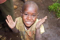 Portrait of pygmy child. KISORO, UGANDA - DECEMBER 31, 2013: Portrait of an unidentified pygmy child smiles into the camera Royalty Free Stock Photo