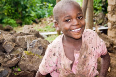 Portrait of pygmy child. KISORO, UGANDA - DECEMBER 31, 2013: Portrait of an unidentified pygmy child smiles into the camera Royalty Free Stock Photography