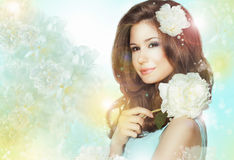 Portrait of Quiet Romantic Woman with Flowers over Colored Bokeh Background Stock Photos