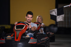 Portrait Of A Race Karting Couple Stock Image