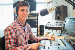 Portrait of radio host using sound mixer Stock Photography
