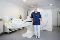 Portrait Of Radiologist Standing By Magnetic Resonance Imaging M Royalty Free Stock Image
