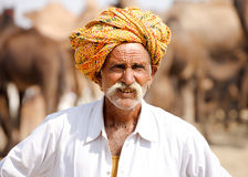 Portrait Rajasthani Indian man attends the Pushkar fair, India. Stock Images