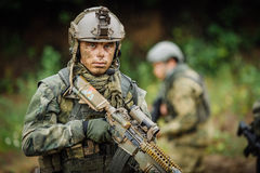 Portrait of a ranger in the battlefield with a gun. Portrait of a ranger in the battlefield with a rifle Royalty Free Stock Photo