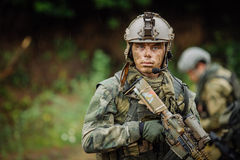 Portrait of a ranger in the battlefield with a gun Royalty Free Stock Photos