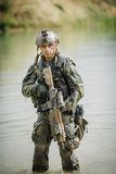 Portrait of a ranger in the battlefield with a gun Stock Image