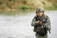 Portrait of a ranger in the battlefield with a gun Stock Photography