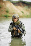 Portrait of a ranger in the battlefield with a gun Royalty Free Stock Images