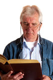 Portrait of a reading elderly man Stock Photos