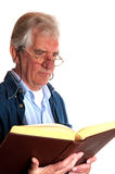 Portrait of a reading elderly man Royalty Free Stock Image