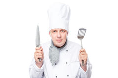 Portrait of ready Chef with shovel and a sharp knife on a white. Background Royalty Free Stock Photo