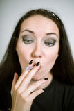 Portrait of a real female smoker Stock Photography