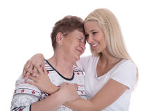 Portrait of real grandmother with her granddaughter. Royalty Free Stock Images